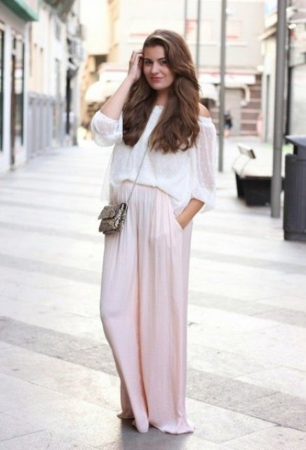 With off the shoulder loose top, heels and mini bag