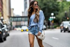 With one shoulder shirt, light blue high heels and white bag