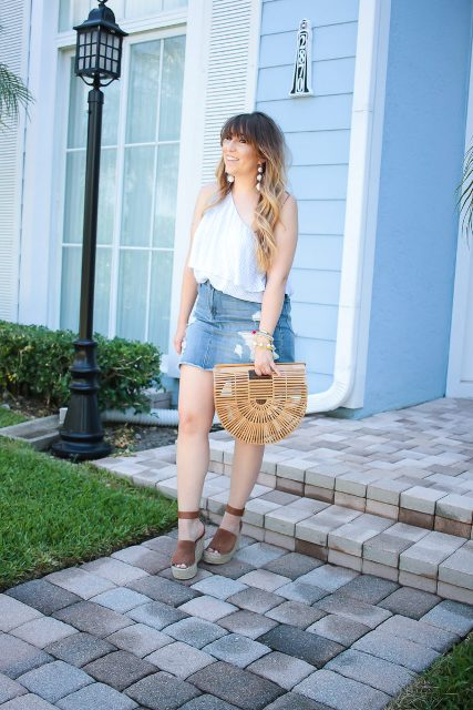 With one shoulder top, platform sandals and straw bag