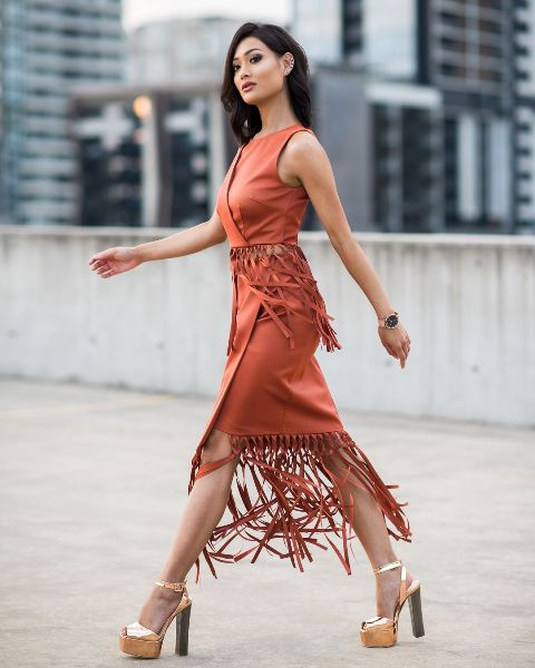 With orange fringe dress
