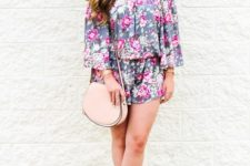 With pale pink bag and high heels