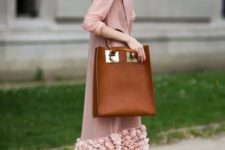 With pale pink maxi dress
