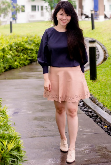With pale pink skirt and white lace up shoes