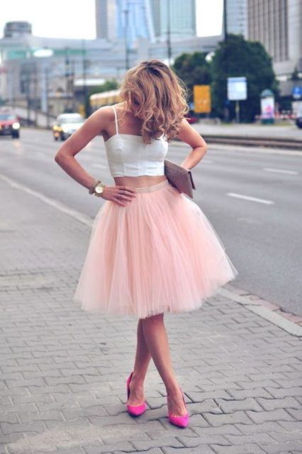 With pale pink skirt, clutch and pink pumps