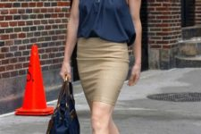 With pencil skirt, blue bag and beige high heels
