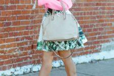 With pink shirt, gray bag and printed skirt