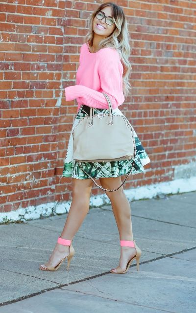 With pink shirt, gray bag and printed skirt