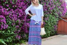 With printed maxi skirt, platform shoes and white and red bag