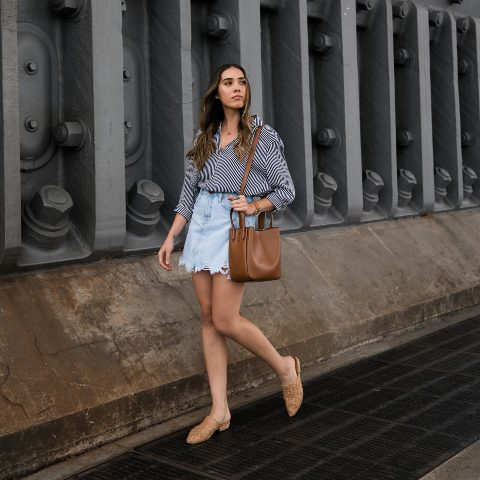 With printed shirt, beige flat shoes and brown leather bag