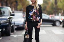 With printed sweatshirt, black skinny pants and high heels