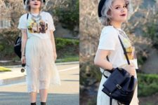 With printed t-shirt, lace midi skirt, black hat and black boots