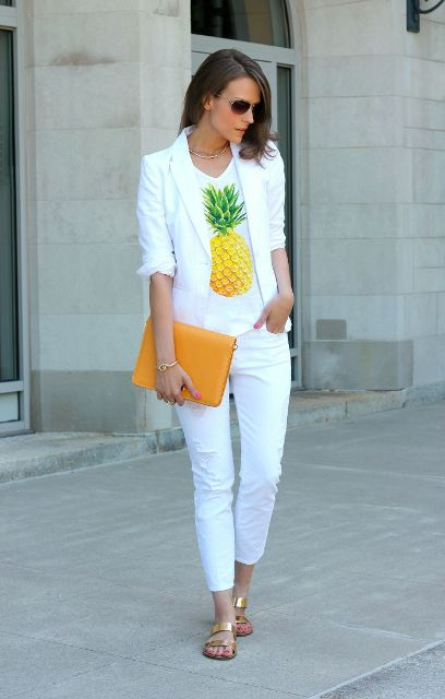 With printed t-shirt, white blazer, white crop trousers and yellow clutch