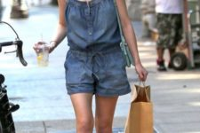 With red and blue flat sandals and mint green bag