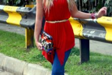 With red top, jeans, suede boots and printed clutch