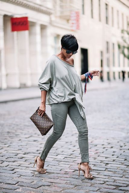 With skinny pants, tassel sandals and printed clutch