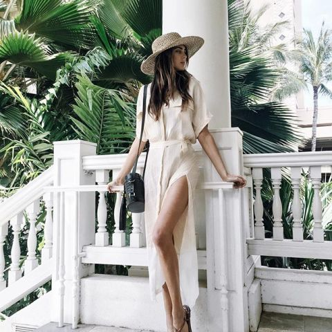 With straw wide brim hat, heels and black bag