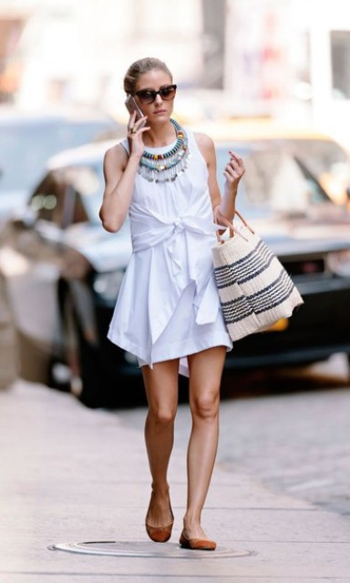 With striped bag, flats and necklace