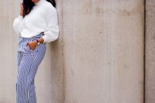 With striped culottes, purple boots and hat