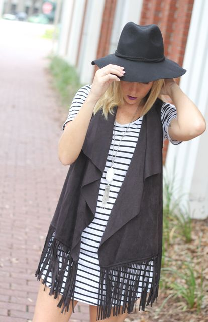 With striped dress and black wide brim hat