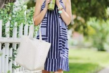 With striped dress and white sneakers