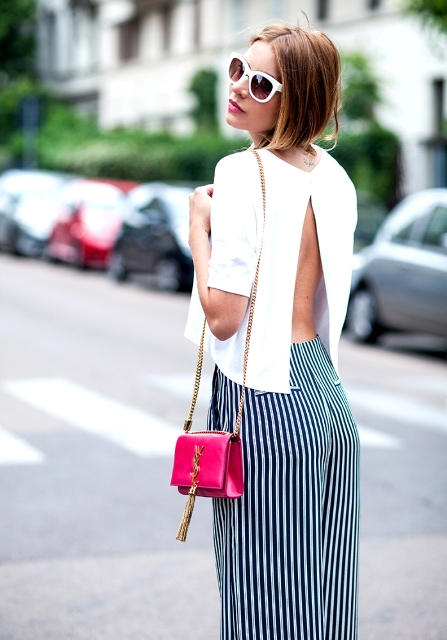 With striped pants and pink mini bag