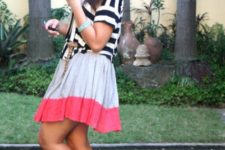 With striped shirt and skater skirt