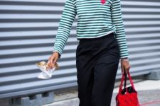 With striped shirt, black straight trousers and white flat sandals