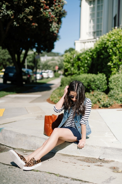 With striped shirt, denim vest, leopard slip on shoes and brown tote