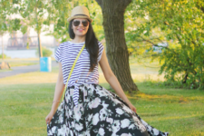 With striped shirt, hat, yellow bag and flat sandals