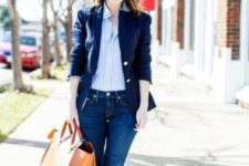 With striped shirt, navy blue jacket, skinny jeans and bag