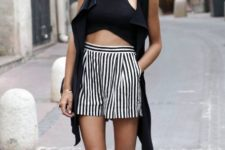 With striped shorts, black vest and bag