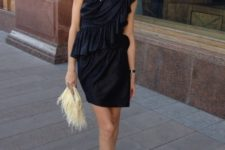 With unique clutch and black and silver shoes