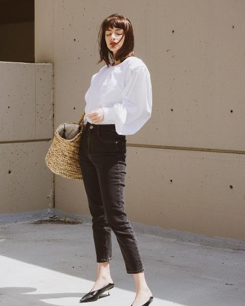 With white blouse, crop jeans and straw bag