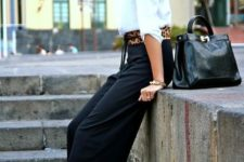 With white blouse, leopard belt, black pumps and black leather bag