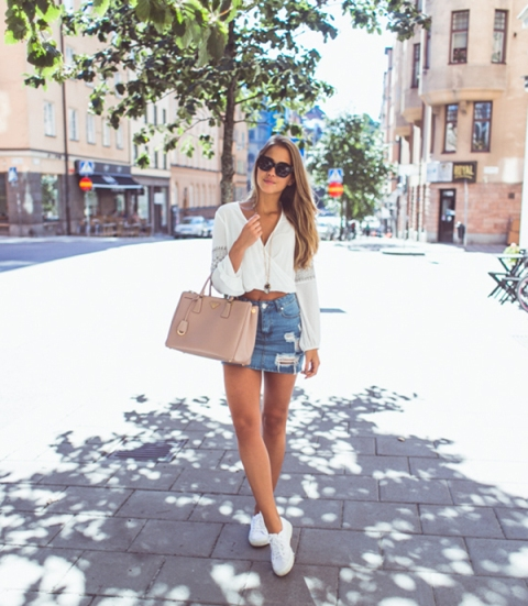 With white blouse, white sneakers and beige bag