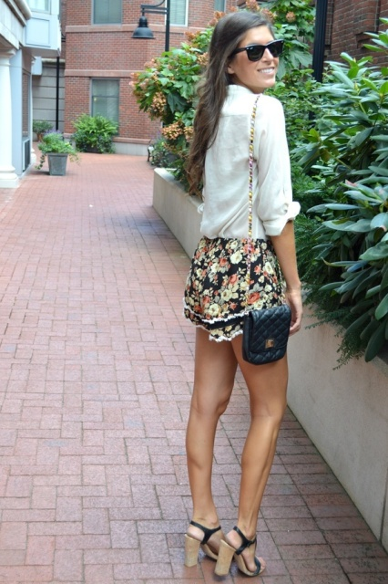 With white button down shirt, black sandals and black chain strap bag