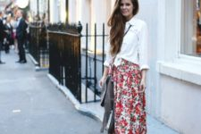 With white button down shirt, fringe bag and platform shoes