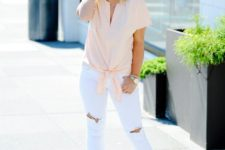 With white distressed pants and sandals