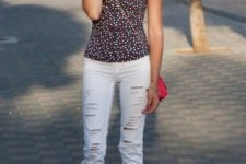 With white distressed pants, red bag and red shoes