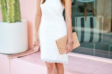 With white dress and beige clutch