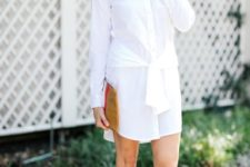 With white embellished flat sandals and clutch