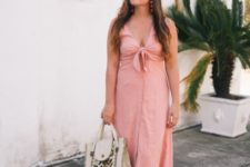 With white floral bag and pale pink sandals