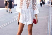 With white high heels and red chain strap mini bag