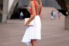 With white knee-length skirt, pastel colored clutch and red heels