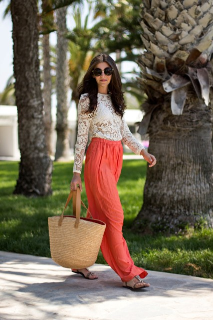 With white lace blouse, flat sandals and big straw bag