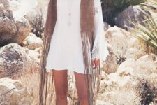 With white lace dress, wide brim hat and ankle boots