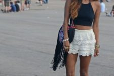 With white lace shorts, fringe bag and ankle boots