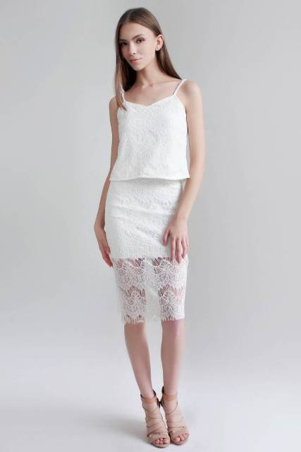 With white lace skirt and beige shoes