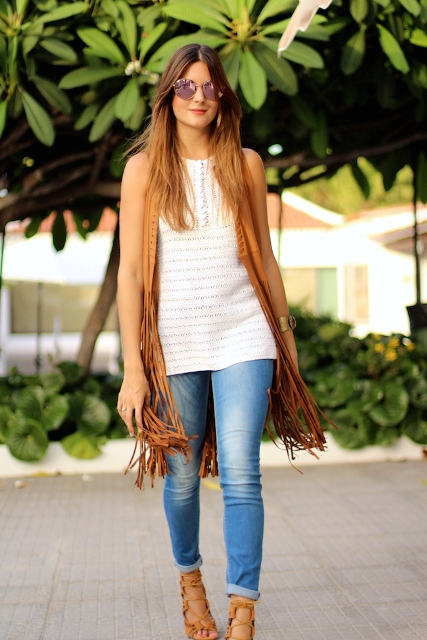With white long top, skinny jeans and brown lace up sandals