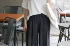 With white loose t-shirt, white slip on shoes and tote